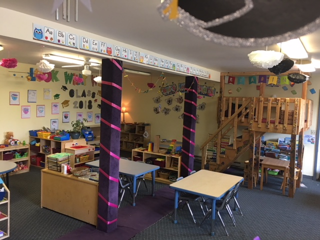 interior of a classroom with two purple columns